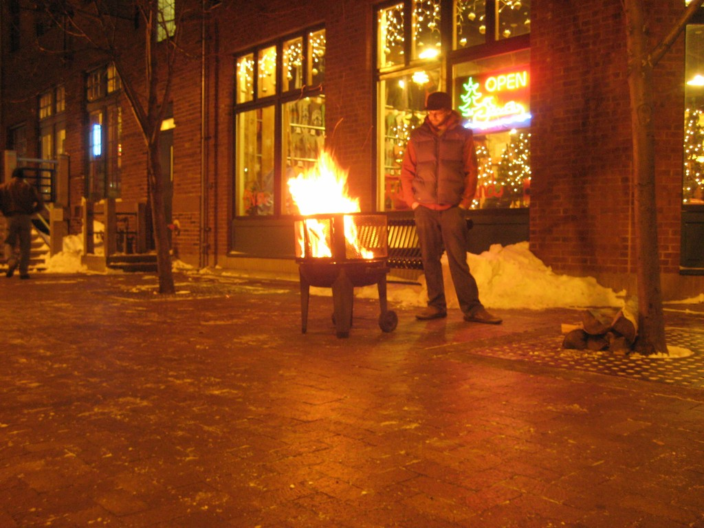 A warming-fire for the public at the Duluth Pack store.