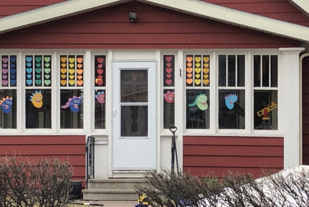 House porch with colorful hearts in windows and fish